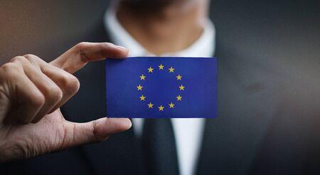 Businessman Holding Card of European Flag