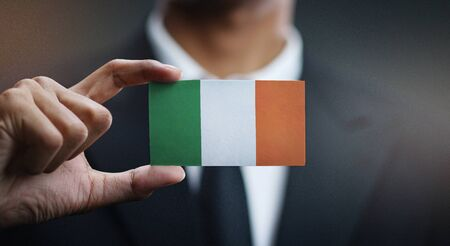 Business man Holding Card of Ireland Flag 写真素材