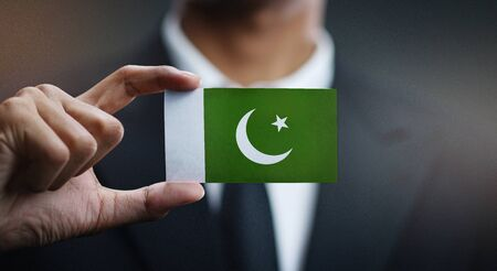 Business man Holding Card Pakistan Flag