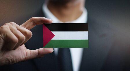 Business man Holding Card Palestine Flag 写真素材