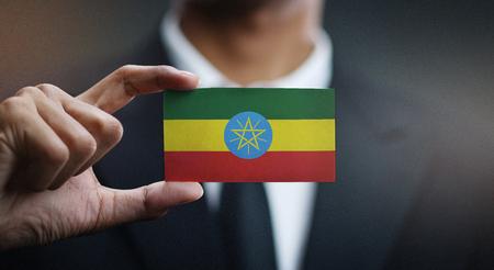 Businessman Holding Card of Ethiopia Flag Editorial