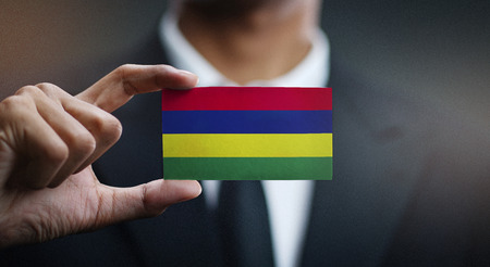 Business man Holding Card of Mauritius Flag