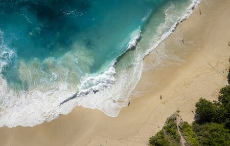 Top Down Drone Shot of Big Waves Kelingking Beach at Nusa Penida, Bali - Indonesia