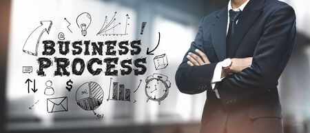 Asian Businessman on Blurred Office Background. Business Process Sketch Concept