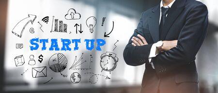 Asian Businessman on Blurred Office Background. Start Up Sketch Concept  写真素材