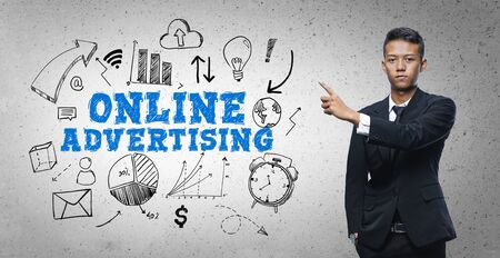 Asian Businessman Pointing Online Advertising Text Sketch Concept 写真素材