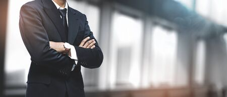 Asian Businessman on Blurred Office Background. Copy Space