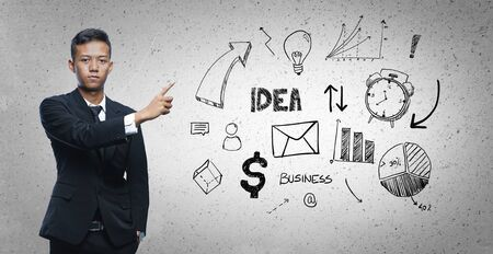 Asian Businessman Pointing Business Sketch Concept 写真素材