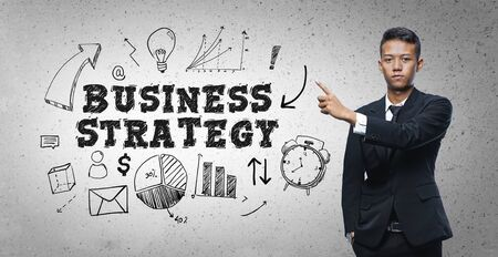 Asian Businessman Pointing Business Strategy Text Sketch Concept 写真素材