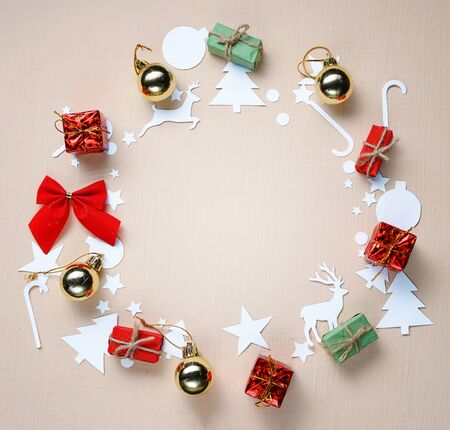 Paper Cutting and Christmas Ornament Forming Circle on Beige Background. Room For Text