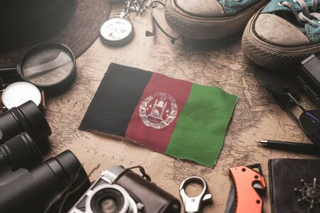 Afghanistan Flag Between Traveler's Accessories on Old Vintage Map. Tourist Destination Concept.