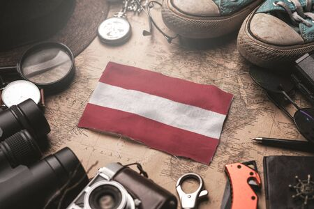 Austria Flag Between Traveler's Accessories on Old Vintage Map. Tourist Destination Concept.  Foto de archivo