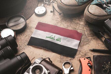 Iraq Flag Between Traveler's Accessories on Old Vintage Map. Tourist Destination Concept.
