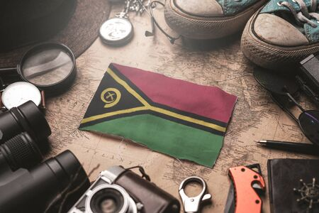 Vanuatu Flag Between Traveler's Accessories on Old Vintage Map. Tourist Destination Concept. Foto de archivo