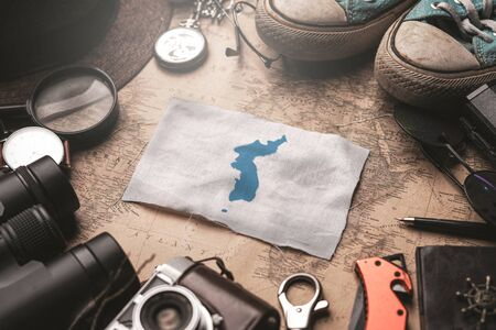 Unification Flag of Korea Flag Between Traveler's Accessories on Old Vintage Map. Tourist Destination Concept. 스톡 콘텐츠