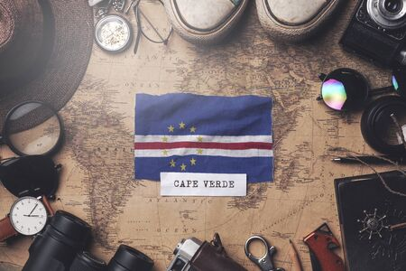 Cape Verde Flag Between Traveler's Accessories on Old Vintage Map. Overhead Shot Foto de archivo