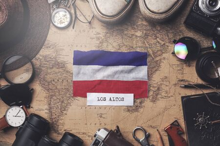 Los Altos Flag Between Traveler's Accessories on Old Vintage Map. Overhead Shot
