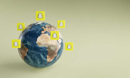 Snapchat Logo Icon Around Earth. Popular App Concept.
