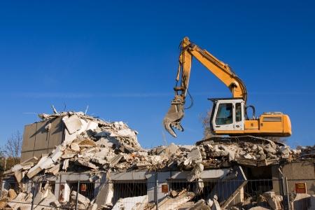demolish: dismantling of a house  Stock Photo