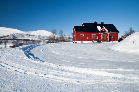 little red house in sweden in the winter Editorial