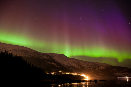 magnetosphere: Aurora borealis display in norway during a strong solar storm in march 2015