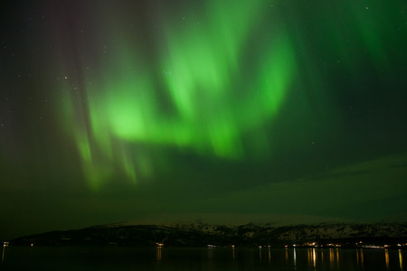 geomagnetic: Aurora borealis display in norway during a strong solar storm in march 2015