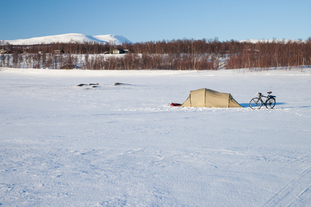 sweden in winter: winter camping on a frozen lake in sweden Stock Photo