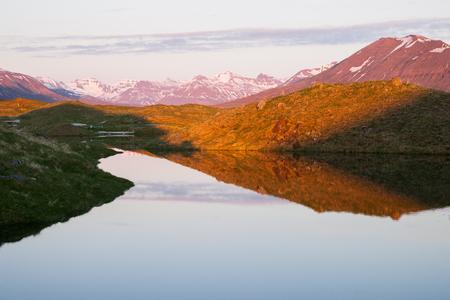 midnight: beautiful icelandic landscape in the shine of the midnight sun Stock Photo