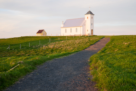 midnight: Church on the island Flatey Iceland at midnight in june