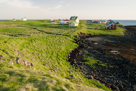 Little houses on Flatey island in Iceland at midnight Standard-Bild