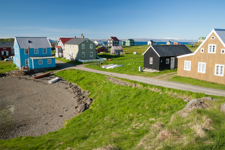 Little houses on Flatey island in Iceland during a sunny day