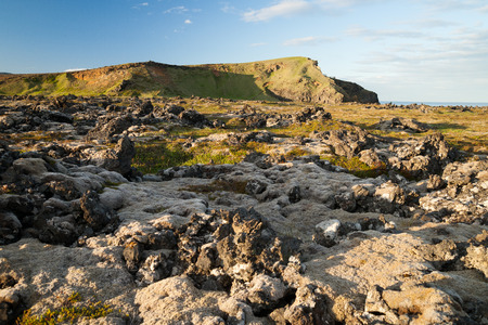 sulight: Lava formation on Snaefellsnes peninsula in Iceland at sunset