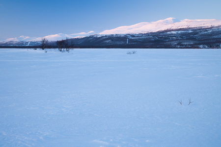 ice floe: evening mood over a frozen lake in sweden Stock Photo