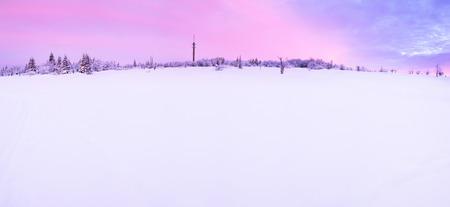erzgebirge: Sunrise over a cold winter landscape with beautiful illuminated clouds