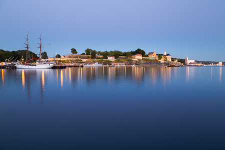 Iluminated Akershus Fortress in Oslo during the blue hour