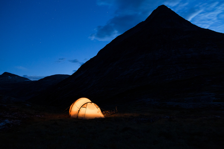 Iluminated tent in Norway at night
