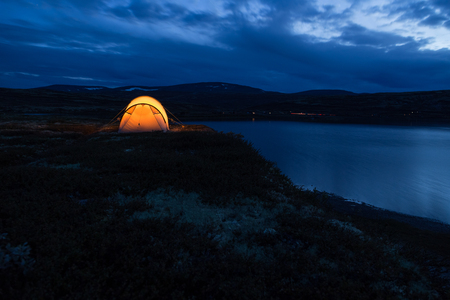 Iluminated tent at night in Norway