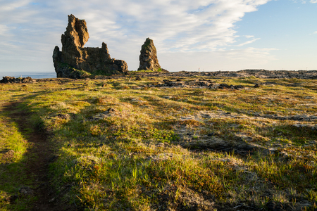 sulight: Lava formation Londrangar on Snaefellsnes peninsula in Iceland at sunset
