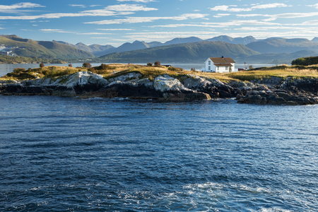 House at the Atlantic coast in Norway during a sunny day Editorial