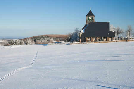erzgebirge: little village with a church in the winter
