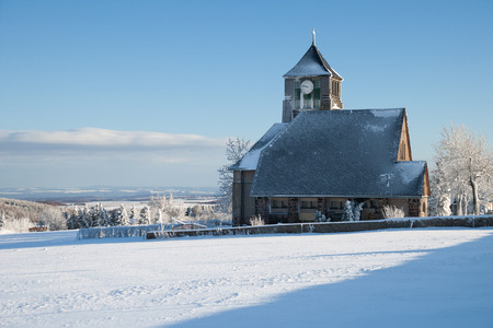 little village with a church in the winter