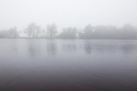 Foggy September morning at a lake Standard-Bild