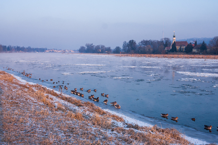 cold sunrise in Dresden with ice floes on the river Stock Photo
