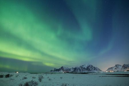 Beautiful northern light display on Lofoten islands in winter