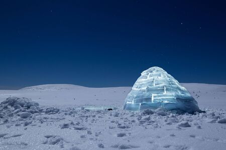 Iluminated igloo during a cold winter nights with bright moonshine Zdjęcie Seryjne