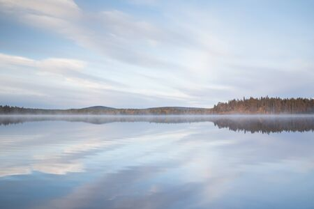 Autumnal lake scenery in Sweden during sunset