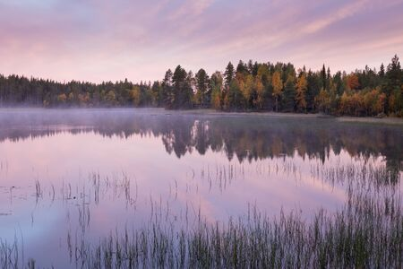 Autumnal lake scenery in Sweden during sunrise