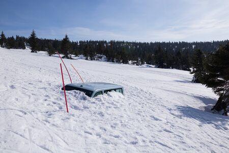 Snow covered car due to a snow chaos Reklamní fotografie