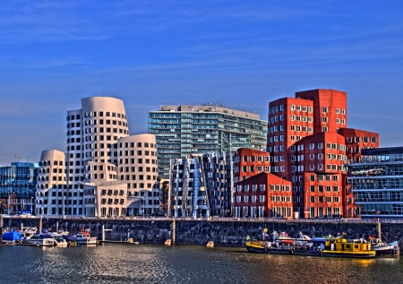 live work city: consumption of processed gehry buildings in media harbour in duesseldorf in hdr Stock Photo