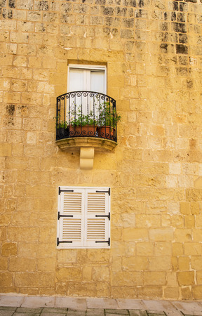 madina: picture of a small balcony and window at a place Pitoresc